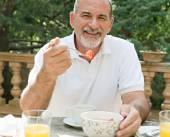 Man having a breakfast — Stock Photo