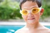 Portrait of a boy relaxing by a swimming pool — Stock Photo