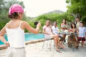 Family posing for a photograph during a vacation together — Stock Photo