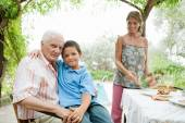 Family on a holiday in a summer home — Stock Photo