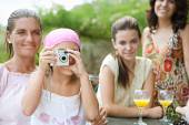 Family relaxing with a camera — Stock Photo
