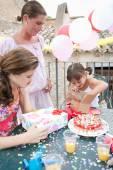 Family celebrating a girl child birthday — Stock Photo