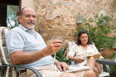 Happy couple relaxing at the resort — Stock Photo