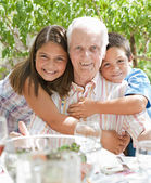 Portrait of a happy grandfather with his grand children — Stock Photo