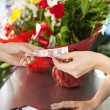 Woman buys a bouquet of flowers — Stock Photo #79000630