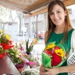 Woman with a bouquet of fresh flowers — Stockfoto #79000652