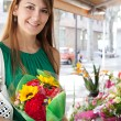 Woman with a bouquet of fresh flowers — Stockfoto #79000658