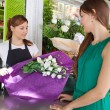 Woman buys a bouquet of flowers — Stock Photo #79000860