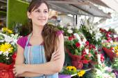 Florist woman in her store — Stock Photo