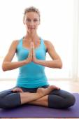 Woman in a yoga position stretching and meditating — Stock Photo