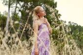 Blond woman relaxing in a field — Stock Photo