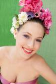 Woman wearing a spring flowers hair dress — Stock Photo