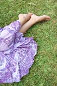 Young woman laying on green grass — Stock Photo
