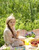 Girl having a picnic in nature — Stock Photo