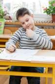 Preschool boy doing enrollment to school — Photo