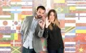Couple making Ok sign over flags background  — ストック写真