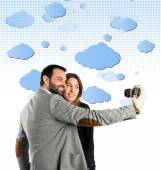 Man photographing with his girlfriend over sky background  — Stock Photo