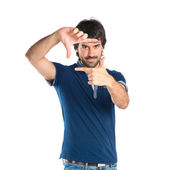 Man focusing with his fingers on a white background — Stock Photo