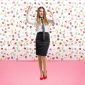 Young businesswoman winning on cute background  — Stock Photo