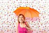 Girl holding an umbrella over colorful background — ストック写真