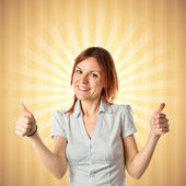 Pretty young girl with thumbs up over pop background  — Stock Photo
