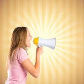 Blonde girl shouting with a megaphone over pop background  — ストック写真