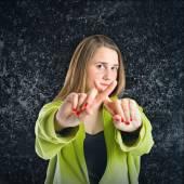 Girl doing NO gesture over black background  — ストック写真