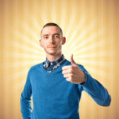 Man with her thumbs up over pop background  — Stock Photo