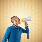 Redhead man shouting by megaphone over pop background  — Zdjęcie stockowe