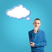 Young man thinking over blue background  — Stock fotografie