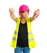 Worker woman doing a bad signal over white background — Foto de Stock