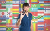 Man making Ok sign over flags background — Stock Photo