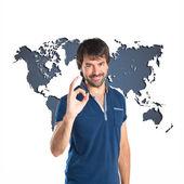 Man making Ok sign over atlas background — Stock Photo