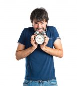 Man holding a clock over white background — Stok fotoğraf
