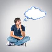 Man thinking over grey background — Stockfoto