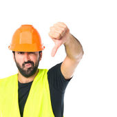 Workman doing a bad signal over white background — Stock Photo