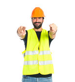 Workman pointing to the front over white background — Stock Photo