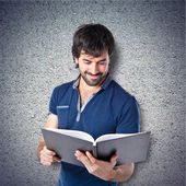Man reading a book over textured background  — Stock Photo