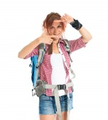 Backpacker focusing with her fingers on a white background — Stock Photo