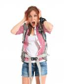 Backpacker doing surprise gesture over white background — Stock Photo