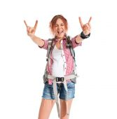 Backpacker making horn gesture over white background — Stock Photo