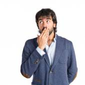 Man doing surprise gesture over white background — Stockfoto