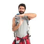 Backpacker making time out gesture over white background — Stock Photo