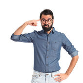 Young hipster man making crazy gesture — Stockfoto