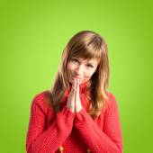 Woman pleading over green background — Stock Photo