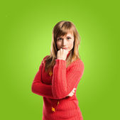 Woman thinking over green background — Stock Photo