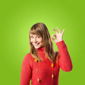 Lucky woman over green background — Stock Photo
