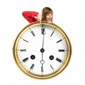 Girl holding a vintage clock over white background  — Stock Photo