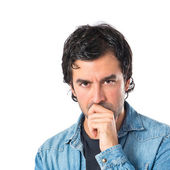 Brunette man thinking over isolated white background — Stock Photo