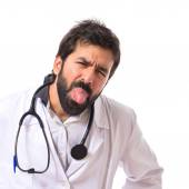Doctor doing a joke over isolated white background — Stockfoto